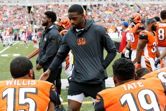Injured Cincinnati Bengals wide receiver A.J. Green (18) walks the sideline in the fourth quarter of the NFL Week 5 game between the Cincinnati Bengals and the Arizona Cardinals at Paul Brown Stadium in downtown Cincinnati on Sunday, Oct. 6, 2019. Despite a fourth quarter comeback, the Bengals fell to 0-5 with a 26-23 loss to the Cardinals.