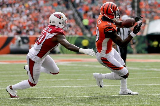 Cincinnati Bengals wide receiver Auden Tate (19) is unable to handle a pass near the goal line as Arizona Cardinals defensive back Tramaine Brock (20) defends ends in the first quarter of an Week 5 NFL football game, Sunday, Oct. 6, 2019, at Paul Brown Stadium in Cincinnati.