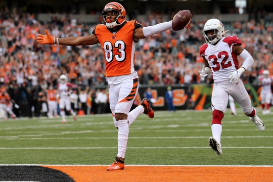 Cincinnati Bengals wide receiver Tyler Boyd (83) scores a touchdown to tie the game in the fourth quarter of an Week 5 NFL football game against the Arizona Cardinalsa, Sunday, Oct. 6, 2019, at Paul Brown Stadium in Cincinnati. The Arizona Cardinals won 26-23.