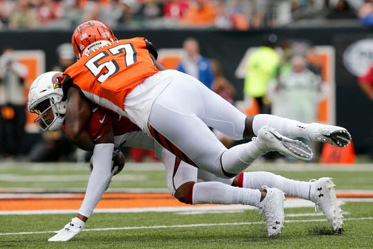 Cincinnati Bengals linebacker Germaine Pratt (57) dives for Arizona Cardinals wide receiver Pharoh Cooper (12) in the second quarter of the NFL Week 5 game between the Cincinnati Bengals and the Arizona Cardinals at Paul Brown Stadium in downtown Cincinnati on Sunday, Oct. 6, 2019. The Cardinals led 13-6 at halftime
