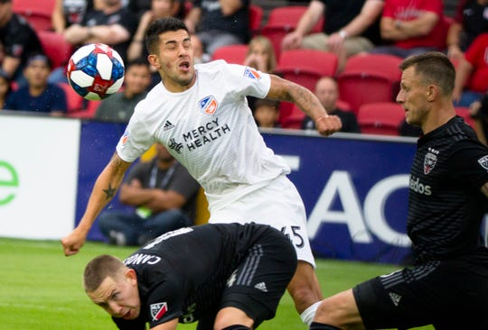 FC Cincinnati midfielder Emmanuel Ledesma (45) heads the ball as D.C. United midfielder Russell Canouse (4) guards him in the first half of the MLS match between FC Cincinnati and D.C. United on Sunday, Oct. 6, 2019, in Washington D.C. at Audi Field.