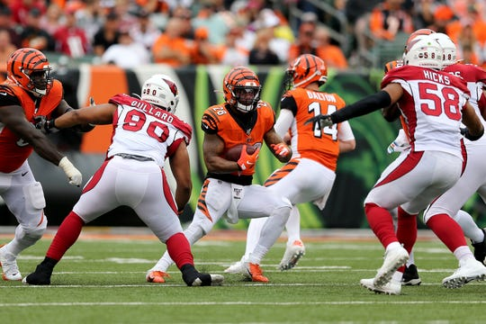 Cincinnati Bengals running back Joe Mixon (28), center, looks for running room in the third quarter of an Week 5 NFL football game against the Arizona Cardinals, Sunday, Oct. 6, 2019, at Paul Brown Stadium in Cincinnati. The Arizona Cardinals won 26-23.