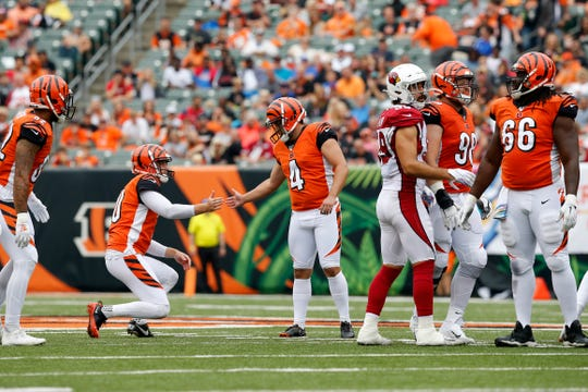 Cincinnati Bengals kicker Randy Bullock (4) and punter Kevin Huber (10) shake hands after a successful field goal in the second quarter of the NFL Week 5 game between the Cincinnati Bengals and the Arizona Cardinals at Paul Brown Stadium in downtown Cincinnati on Sunday, Oct. 6, 2019. The Cardinals led 13-6 at halftime
