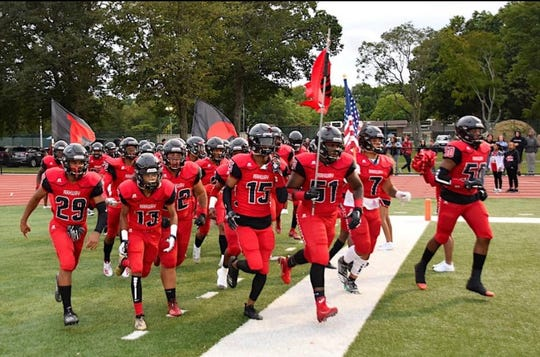 Rahway football players take the field during a 2019 game.