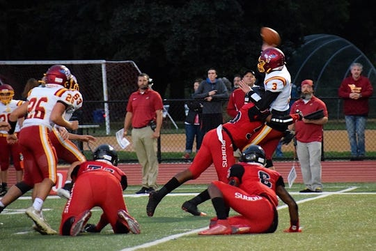 The Rahway football team plays defense.