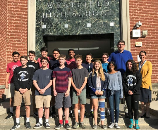 Twenty-five Westfield High School (WHS) students achieved perfect scores on ACT and/or SAT subject areas over the summer. Westfield High School principal Mary Asfendis (far right) congratulates WHS seniors who received perfect scores on June 2019 SAT subject tests. (First row, left to right) Ryan Billings, Samuel Ertman, Max Tennant, Aidan Kilbourn, Grace Endy, Mira Mehta, and Abbey Zidel. (Back row, left to right) Spencer Rothfleisch, Thomas Lupicki, Henry Meiselman, Alan Solovey, Sivaji Turimella, Kurt Hu, Zachary Fischer, and Matthew Arndt.