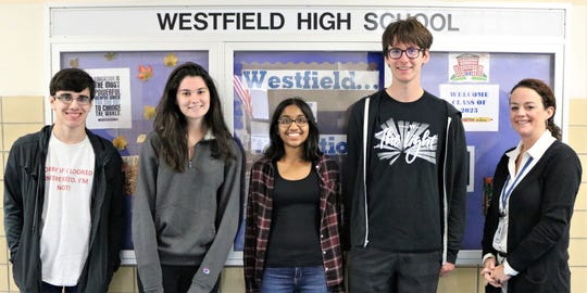 Twenty-five Westfield High School students achieved perfect scores on ACT and/or SAT subject areas over the summer. (Left to right) Westfield High School (WHS) seniors Mark Falletta, Madeline Stack, Mira Mehta and Maxwell Scialabba earned perfect scores on August 2019 SAT subject tests. They are pictured here with WHS principal Mary Asfendis.