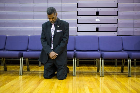 Flint Council member Eric Mays, a retired GM assembly worker joins others in worship at Cathedral of Faith Ministries Church of God in Christ in Flint, Mich., Sunday, October 6, 2019.