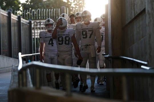 Michigan State kickers Cole Hahn (98), Tyler Hunt (97) and Matt Coghlin (4) walk down the tunnel for warm up at Ohio Stadium in Columbus, Ohio, Saturday, Oct. 5, 2019.