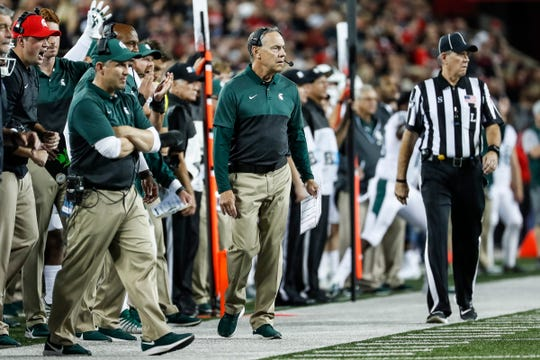 Michigan State head coach Mark Dantonio, center, and defensive coordinator Mike Tressel, left, watch a play during the first quarter against Ohio State at Ohio Stadium in Columbus, Ohio, Saturday, Oct. 5, 2019.