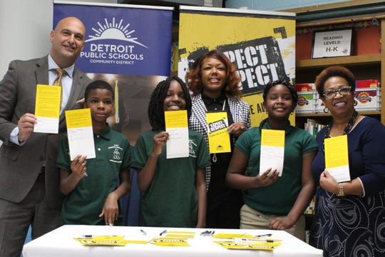 Detroit Schools Superintendent Nikolai Vitti (left), and school board members Angelique Peterson-Mayberry and Corletta Vaughn (back left and right), signed the Detroit district's new anti-bullying pledge alongside students at Mann Learning Community.