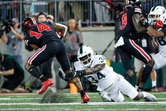 Michigan State linebacker Antjuan Simmons tackles Ohio State receiver K.J. Hill during the first quarter at Ohio Stadium in Columbus, Ohio, Saturday, Oct. 5, 2019.