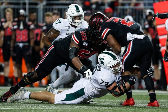 Michigan State defensive tackle Mike Panasiuk tackles Ohio State running back J.K. Dobbins during the first quarter at Ohio Stadium in Columbus, Ohio, Saturday, Oct. 5, 2019.