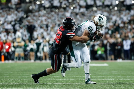 Michigan State tight end Matt Seybert makes a catch against Ohio State linebacker Tuf Borland during the first half at Ohio Stadium in Columbus, Ohio, Saturday, Oct. 5, 2019.