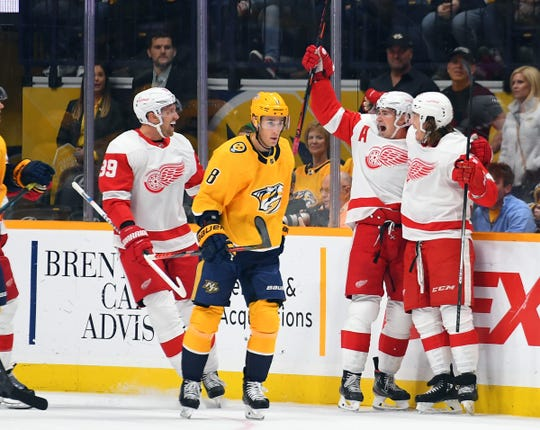 Detroit Red Wings left wing Tyler Bertuzzi, right, celebrates with Dylan Larkin, center, and Anthony Mantha, left, after a goal during the first period against the Nashville Predators, Saturday, Oct. 5, 2019, in Nashville.