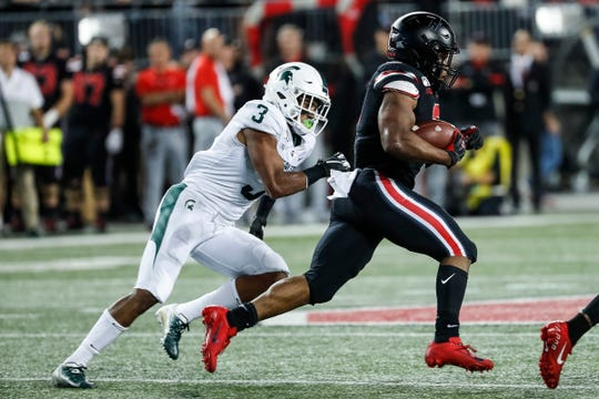 Michigan State safety Xavier Henderson can't catch Ohio State running back J.K. Dobbins during the first half at Ohio Stadium in Columbus, Ohio, Saturday, Oct. 5, 2019.