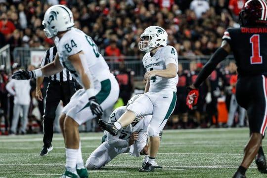 Matt Coghlin kicks a field goal against Ohio State on Saturday.