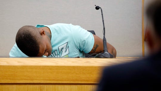 Joshua Brown, a neighbor of victim Botham Jean, is overcome with emotion while giving testimony in court, in Dallas, after recounting how he'd heard Jean singing gospel and Drake songs across the hall before he was fatally shot.