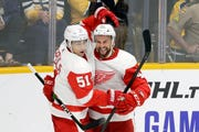 Detroit Red Wings center Luke Glendening (41) is congratulated by Valtteri Filppula (51), of Finland, after scoring against the Nashville Predators during the third period.