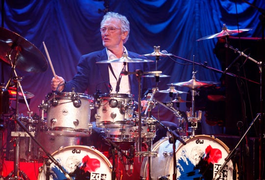 In this Sunday, Dec. 7, 2008 file photo, Ginger Baker performs at the 'Zildjian Drummers Achievement Awards' at the Shepherd's Bush Empire in London.