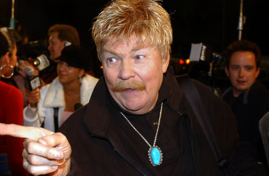 Rip Taylor talks with reporters before a film premiere, in the Hollywood section of Los Angeles in this 2002 file photo.