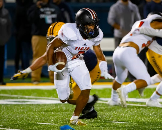 Andre Seldon of Belleville runs with the football against Dearborn Fordson on Friday night.