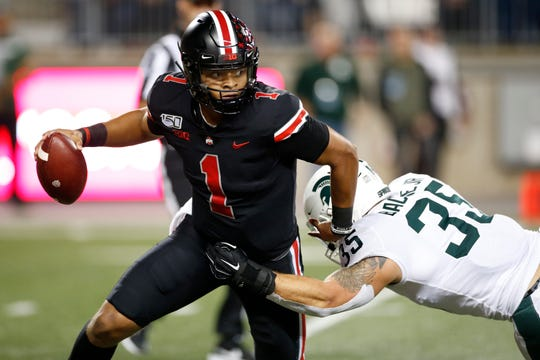 Ohio State quarterback Justin Fields threw for two touchdowns and rushed for a third Saturday night against Michigan State.