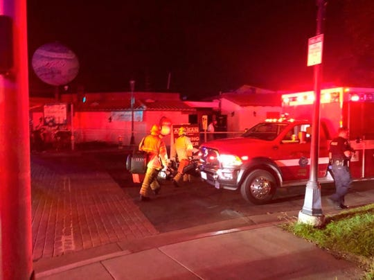 """Emergency personnel respond to utility pole explosions where multiple people were injured at the Old World Village on Saturday, Oct. 5, 2019, in Huntington Beach, Calif. """"It was just like one giant fireball that went up"""" Megan Houck, 26, of Long Beach, Calif., said after an explosion occurred at the shopping and dining complex."""