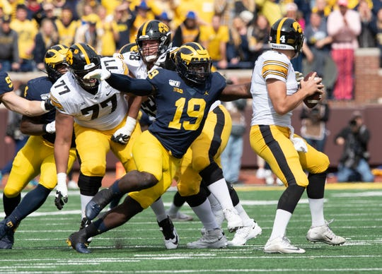 Michigan defensive lineman Kwity Paye (19) collected 2.5 sacks against Iowa.