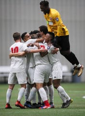 Michigan Stars players, including goalkeeper Tatenda Mkurva (yellow jersey), celebrate the team's 2-0 win over Napa Valley 1839 FC at Ultimate Soccer Arenas Sept. 26.