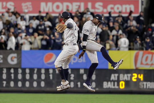 New York Yankees shortstop Didi Gregorius, left, and Cameron Maybin celebrate after the Yankees beat the Minnesota Twins 8-2 in Game 2.