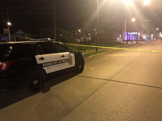 Police work the scene of a shooting outside a Kansas City, Kansas bar Sunday, Oct. 6, 2019.