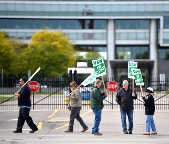 UAW GM and Aramark Local 160 active members and one retiree picket in front of Gate 11 at the GM Tech Center in Warren, Saturday, October 5, 2019.