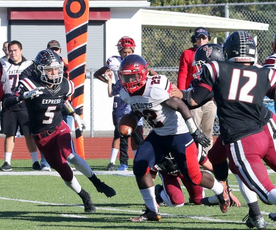 Mose Hill picks up yardage for Binghamton in a 63-35 loss to Elmira on Oct. 5, 2019 at Ernie Davis Academy.