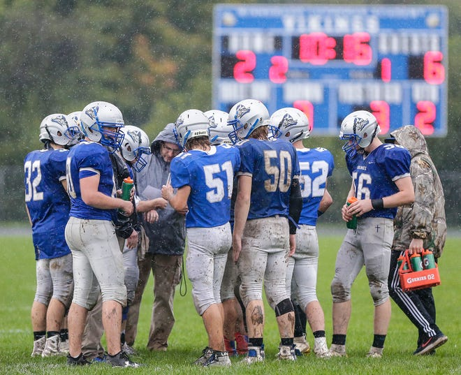 Winnebago Lutheran players huddle during a timeout against Lomira during a 2019 game. The Flyway Conference has moved all high-risk sports, including football, to the alternate spring season.