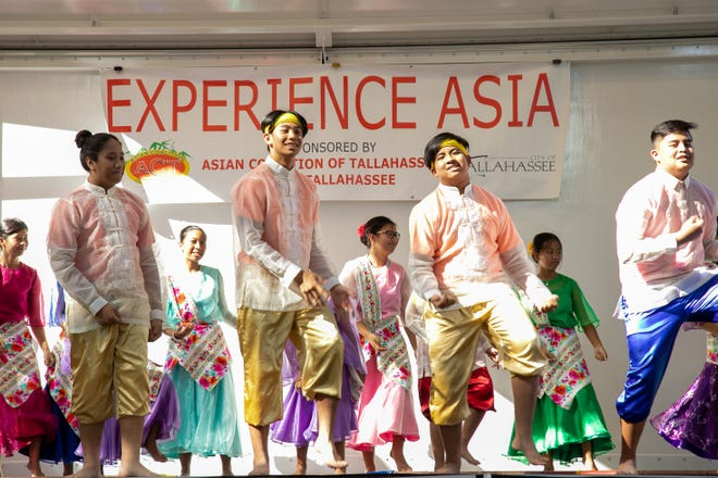 Performers put on a dance demonstration for an audience of hundreds at the Experience Asia festival.