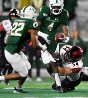 Colorado State receiver Nate Craig-Myers tries to hand the ball off to teammate Dante Wright while being tackled by San Diego State's Caden McDonald in the final minutes of the Rams' 24-10 loss to the Aztecs on Saturday, Oct. 5, 2019, at Canvas Stadium. CSU faces New Mexico at 6 p.m. Friday in Albuquerque in a game that will be telecast nationally by CBS-Sports Network.