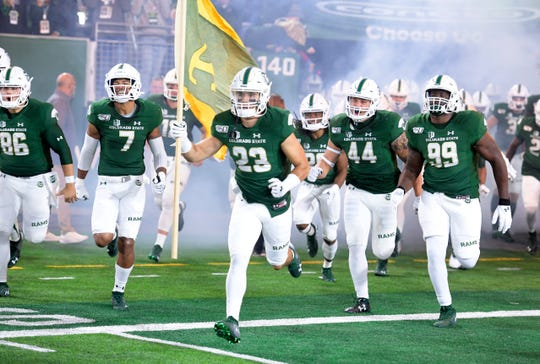 Colorado State's football team runs onto the field at Canvas Stadium before an Oct. 5, 2019, game against San Diego State. The Rams return home Saturday for a 1:30 p.m. game against UNLV.