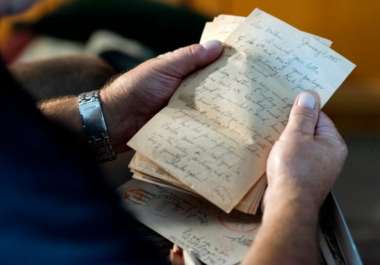 Dave Sheen holds letters written by his father Tuesday, Sept. 17, 2019, at his home in Janesville, Wis.