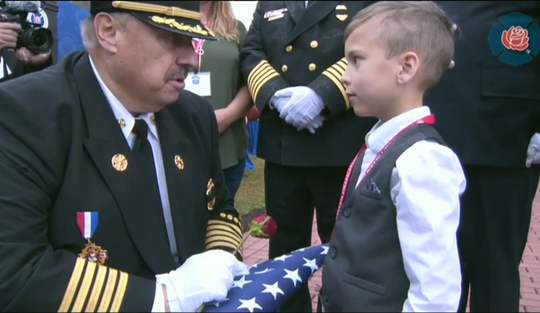 A rose and a flag were given Sunday to families representing 119 firefighters honored during the National Fallen Firefighters Memorial in Maryland. Former Black Eagle fire chief Tom O. Martin was honored. Martin's great-nephew, Troy Zegarski, 6, received the flag and rose from a firefighter at the service.