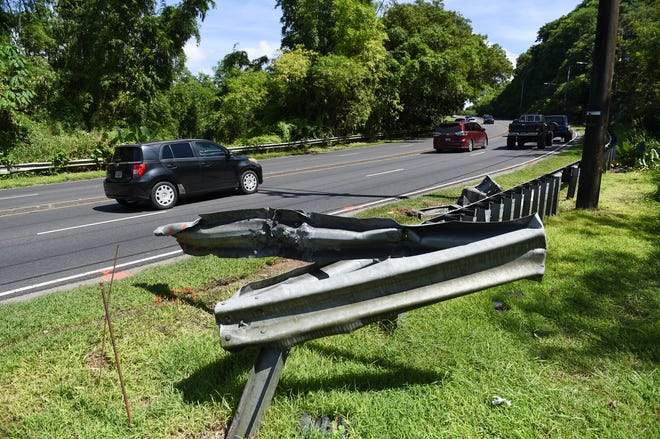 A damaged guardrail is shown at the site of a fatal motorcycle crash on Route 4 in Hagåtña on Oct. 6, 2019.