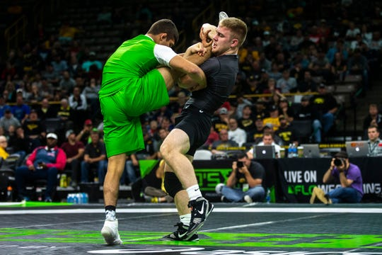 Patrick Kennedy, of Minnesota, wrestles Alex Facundo, of Michigan, at 170 pounds during Flowrestling's Who's Number One event, Saturday, Oct., 5, 2019, at Carver-Hawkeye Arena in Iowa City, Iowa.