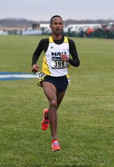 FILE – Futsum Zienasellassie, a North Central graduate, was a surprise winner of the 10-mile run at the U.S. Track and Field Championships.