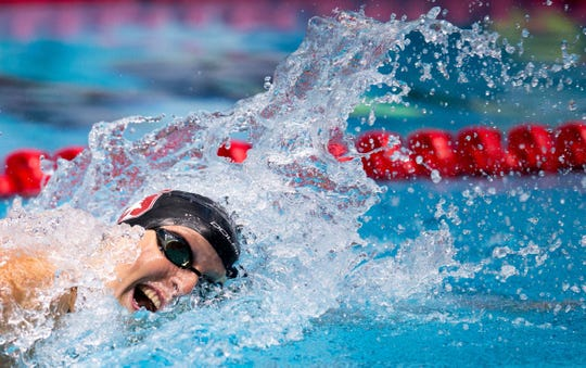 FILE -- Katie Ledecky competes at the  Natatorium at IUPUI in 2017.