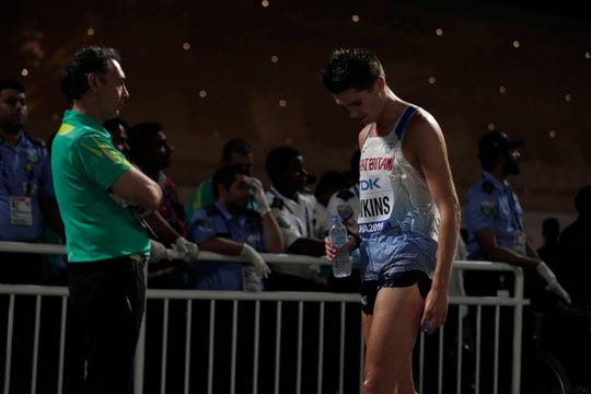 Callum Hawkins, of Great Britain, leaves after finishing the men's marathon at the World Athletics Championships in Doha, Qatar, Sunday, Oct. 6, 2019.