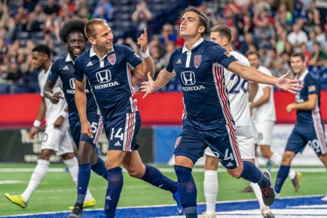 Cristian Novoa (24) celebrates his first goal with Indy Eleven in a 3-0 win over Memphis at Lucas Oil Stadium on Saturday.