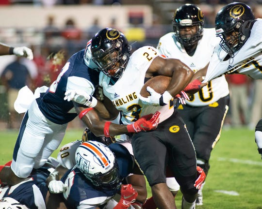 Grambling State RB Keilon Elder (23) is tackled by Jackson State University defense during the W. C. Gorden Classic matchup against  JSU held at Mississippi Veterans Memorial Stadium in Jackson on Saturday, Oct. 5, 5019.