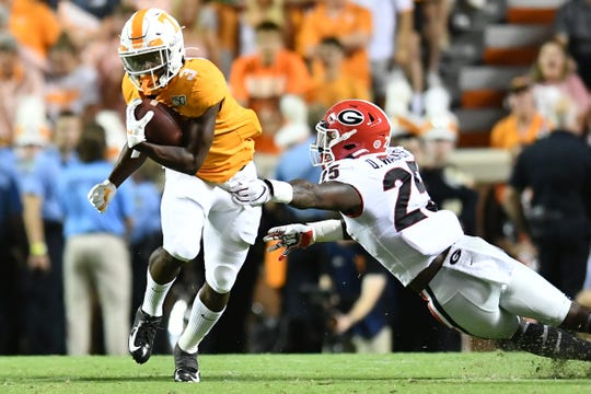 Tennessee running back Eric Gray (3) runs the ball as Georgia inside linebacker Quay Walker (25) defends during a game between Tennessee and Georgia in Neyland Stadium in Knoxville, Tennessee on Saturday, October 5, 2019.