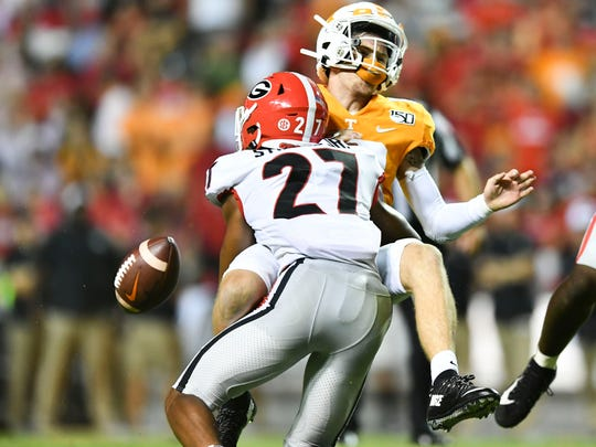 Tennessee quarterback Brian Maurer (18) fumbles the ball while sacked by Georgia defensive back Eric Stokes (27) on Saturday, October 5, 2019.