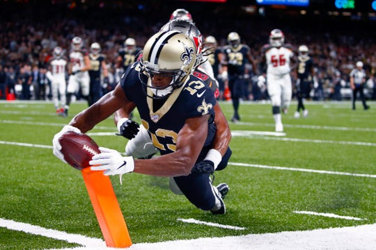 New Orleans Saints wide receiver Michael Thomas (13) scores a touchdown against Tampa Bay Buccaneers cornerback Vernon III Hargreaves in the first half of an NFL football game in New Orleans, Sunday, Oct. 6, 2019. (AP Photo/Butch Dill)